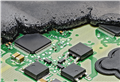 In an overmolding electronic control unit, the electronic components, which are arranged on a printed circuit board as is normally the case, are completely embedded in plastic.
