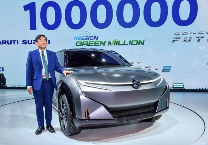 "Maruti Suzuki India's Kenichi Ayukawa (seen with the Futuro-e concept): ""We aim to manufacture and sell the next million green vehicle at a much faster pace, over the next couple of years."""