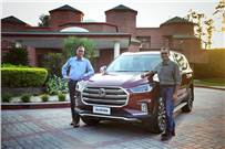 L-R: Rajeev Chaba, president & MD, MG Motor India and Gaurav Gupta, chief commercial officer, MG Motor India unveil the MG Gloster SUV.