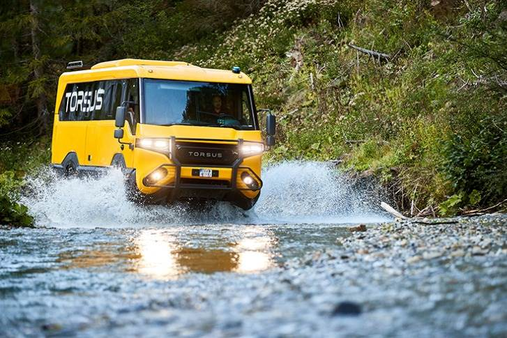 The heavy-duty off-road buses can wade through water up to 900mm deep.