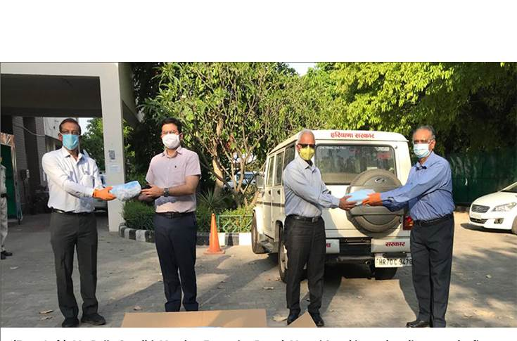 From Left: Rajiv Gandhi, Member Executive Board, Maruti Suzuki seen handing over the first batch of 200,000 units of triple-ply face masks to Amit Khatri, IAS, District Magistrate, Gurugram; Ram Natarajan, ED & CEO, Maruti Krishna Group handing them over to VS Kundu ACS Haryana and CEO,GMDA.