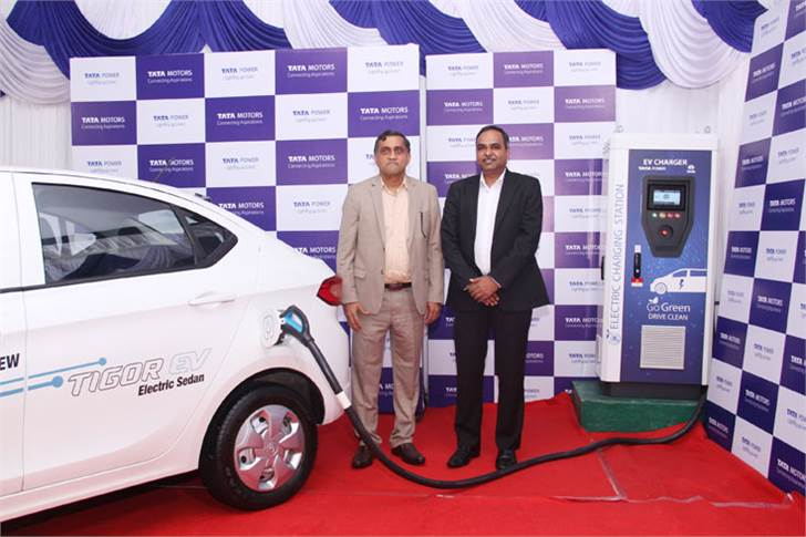 L-R: Ramesh Subramanyam, CFO & President - New Businesses and Shailesh Chandra, President – E-Mobility Biz Divn, Tata Motors with a Tata Tigor EV and the new charging station at Concorde Motors, Pune
