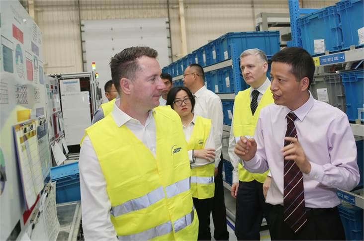 Jason Yang (right, Plant Manager - Qingdao, Norma Group) gives Scott Emery (left, EVP - Purchasing China and APAC, JLR) a tour through the production facilities at the Norma Group's Qingdao plant.