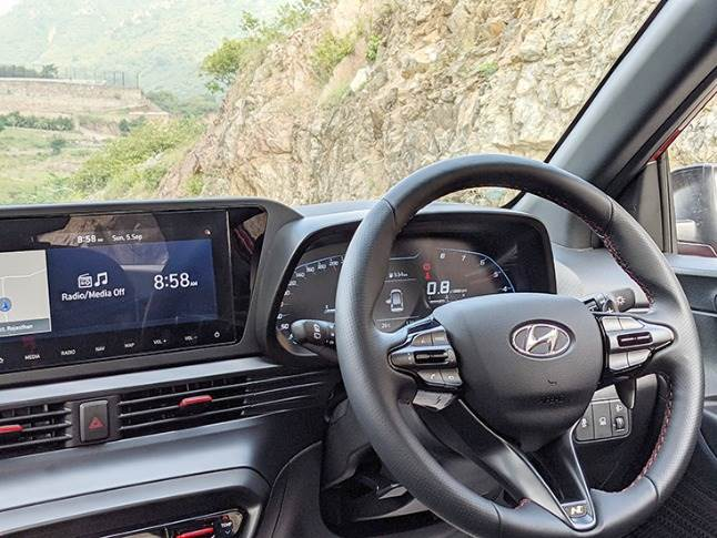 Full-digital instrument cluster with premium steering wheel add to feel-good factor.