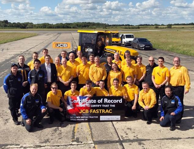 The happy JCB team with the proof of the run officially ratified by Guinness World Records.