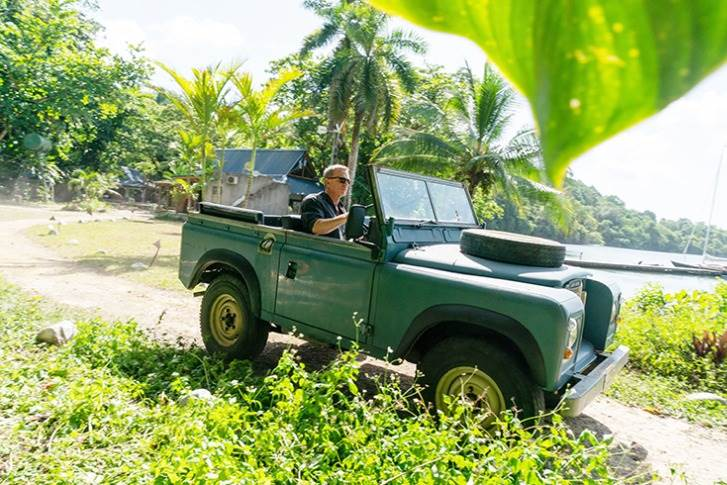 Daniel Craig at the wheel of the 3. James Bond in his Land Rover Series III in verdant Jamaica.