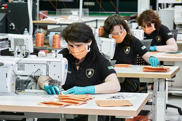 Lamborghini upholstery workers producing surgical masks for the Sant'Orsola-Malpighi Hospital in Bologna to be used in the fight against the COVID-19 pandemic.