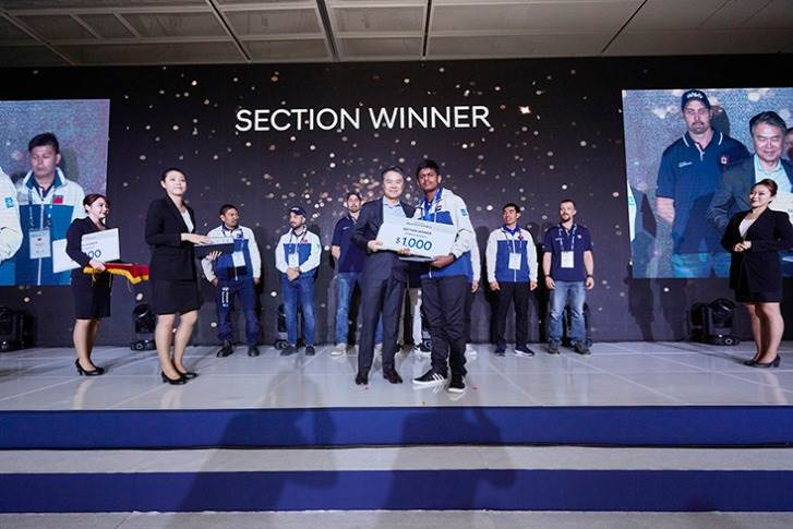 Sanchit, from Trident Hyundai in Bangalore and representing Hyundai Motor India, receiving the gold medal and the cash reward at the Hyundai Group
