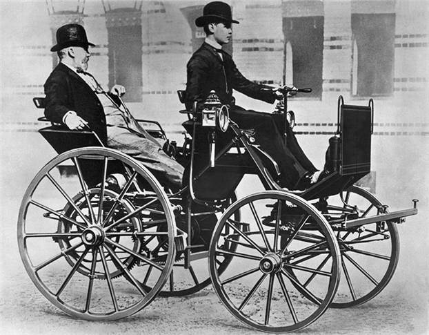 Gottlieb Daimler (17 March 1834 to 6 March 1900) enjoying a ride in the back seat of his