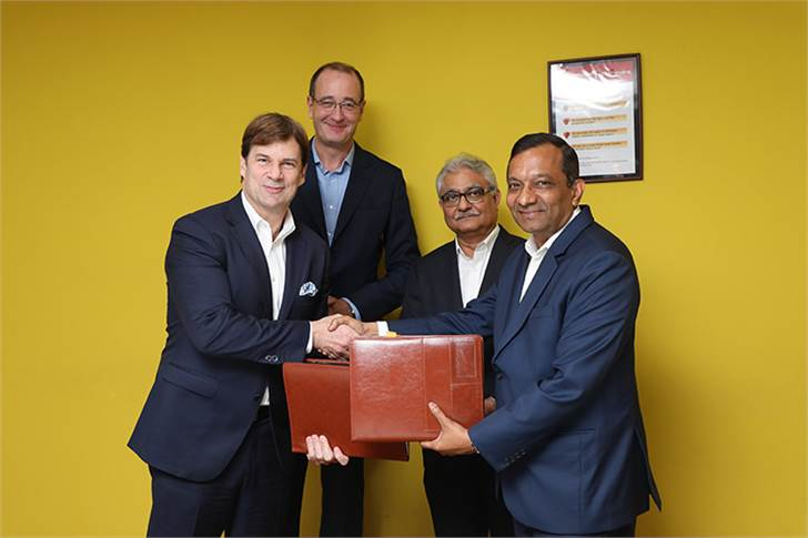 Ford and Mahindra are putting into action their MoU signed on March 22, 2018. L-R: Ford