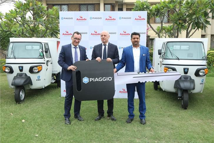 L-R: Diego Graffi. MD and CEO Piaggio India handing over keys of special purpose vehicles to Mr. Dixit, CMD, Ananda Diary. Also seen Alessandro De Masi (Centre) from the Embassy of Italy in India.