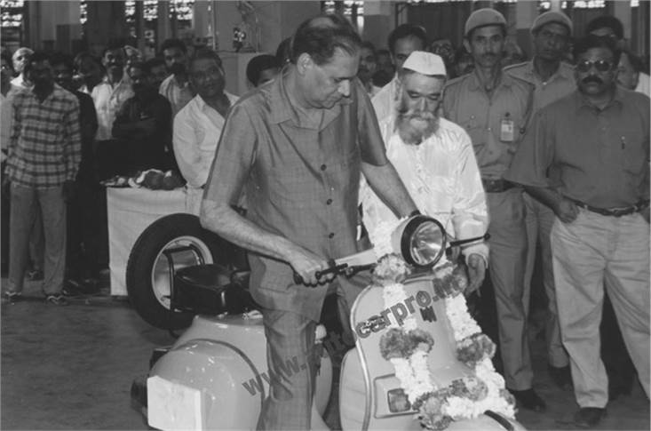 Rahul Bajaj checks out a Chetak scooter, which rolled out in 1972 and was phased out 33 years later only to be reborn as an electric scooter in 2019.