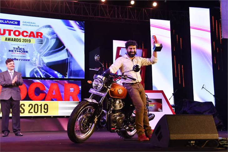 Siddhartha Lal, managing director and CEO, Eicher Motors with the Bike of the Year 2019 – the Royal Enfield Interceptor 2019.