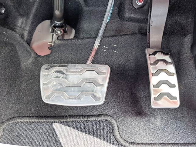 Sporty aluminium pedals gel well with the performance attitude.