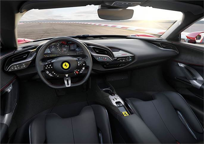 "An HUD features for the first time. Ferrari claims 80% of the car's functions can be controlled from the new steering wheel, citing that ""eyes on the road, hands on the wheel"" was a key safety driver."