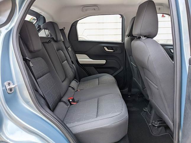 Rear seat is wide to accomodate three passengers, but offers adequate legroom, headroom and comfort.