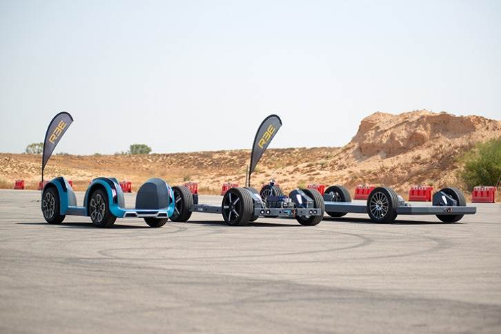 P1, P2 and P4 EV platforms on a desert track. They use the REEcorner module which utilises full X-by-Wire tech for steering, braking and drive all in the arch of the wheel, enabling fully-flat chassis