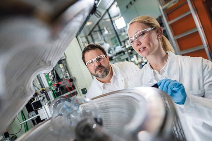 Battery recycling closes the loop in electromobility: The recycling process produces the so-called 'black mass', which is processed by BASF lab technician Stefan Schleicher (left) and chemist Dr. Birgit Gerke (right).