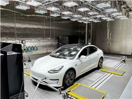 The new solar simulation system plays an important role for globally applicable regulatory tests of both EVs and ICE vehicles. A Tesla in the FEV lab. (Source: FEV Group)