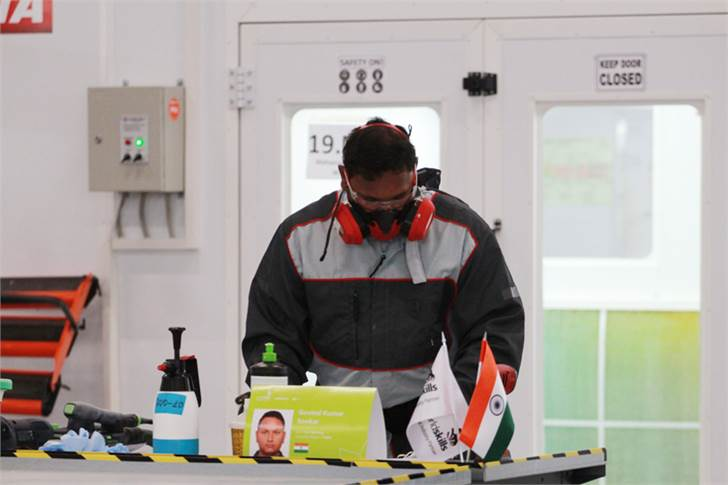 Govind Kumar Sonkar, who won the Medallion for Excellence, in Car Painting, engaged in the contest.