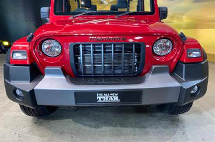 The new Mahindra Thar retains the instantly recognisable shape of its predecessor, along with signaturedesign cues – circular headlights, a seven-slot grille, chunky wheels and boxy tail-lights.