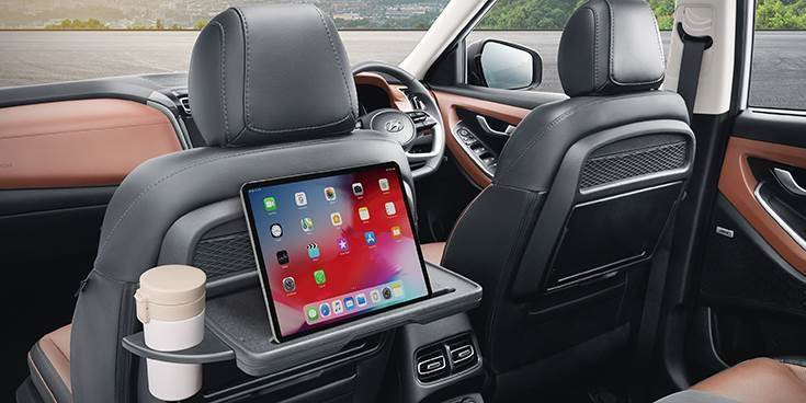 Key highlights include a 10-25-inch multi-display digital cluster, 8-speaker Bose sound system, and front row seatback table with retractable cupholder and IT device holder.