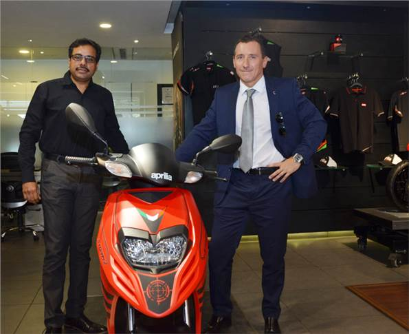 L-R: Ashish Yakhmi, head of the two-wheeler business, and Diego Graffi, MD and CEO, Aprilia India, with the new Aprilia Storm 125.