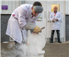 Dr Thomas Grandjean from WMG, University of Warwick handling the battery cell frozen by liquid nitrogen,