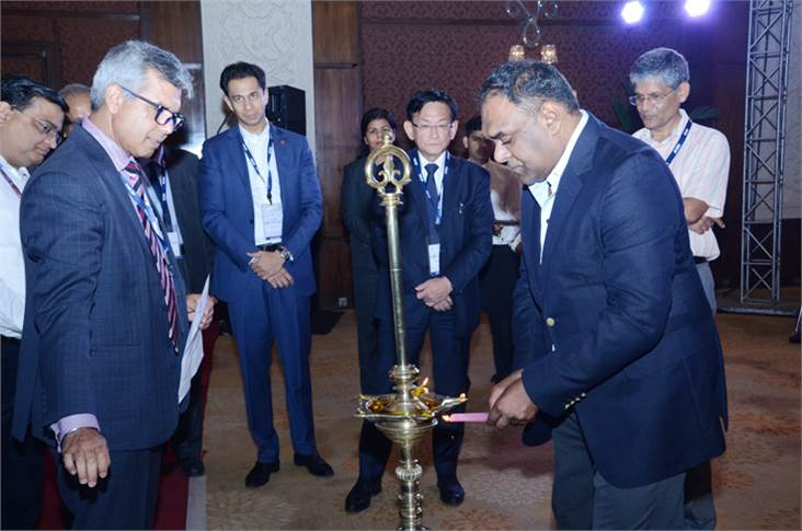 Ram Venkataramani, president, ACMA, lights the traditional lamp as Vinnie Mehta, director general, ACMA, looks on, along with other leading industry heads.