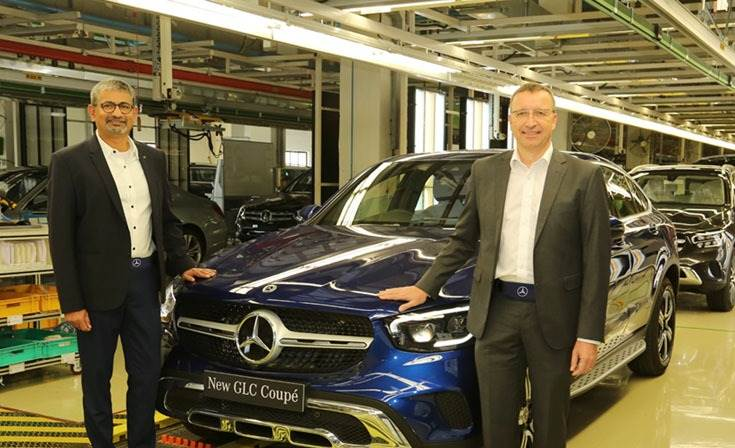 Martin Schwenk, MD and CEO, Mercedes-Benz India and Piyush Arora (left), executive director, Operations, with the new GLC Coupé at the Chakan plant, the 10th product in its 'Made-in-India' portfolio.