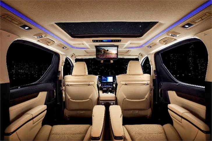 The three-row Vellfire MPV's key focus is on the middle-row, which comes with two large chairs replete with an armrest-mounted console that allows for multiple seating configurations.