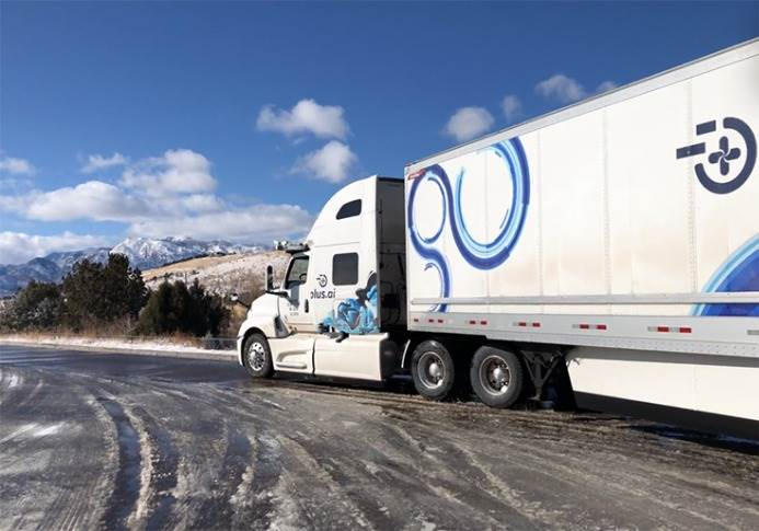 The truck driving in sleet conditions.