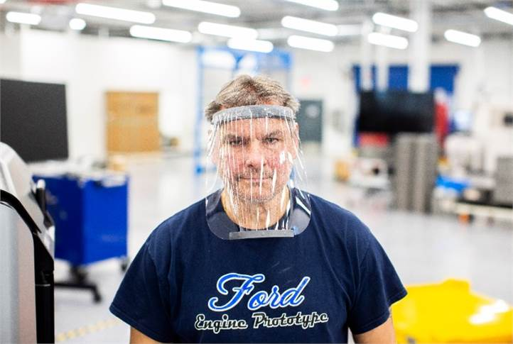 Dave Jacek wears a prototype of a 3D-printed medical face shield printed at Ford's Advanced Manufacturing Center.