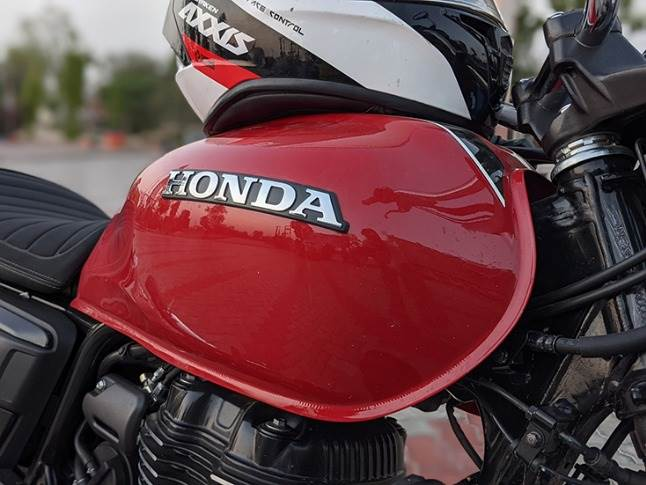 High-quality paint finishing with a stick-on Honda emblem is a classic touch.