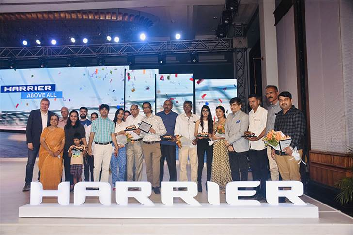 The first five customers for the Tata Harrier and their families get a photo op with CEO and MD, Guenter Butschek and sales chief Mayank Pareek