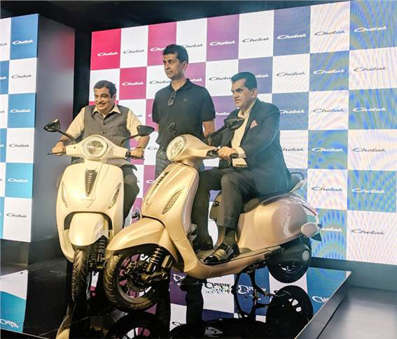 Transport minister Nitin Gadkari, Rajiv Bajaj, MD, Bajaj Auto and Amitabh Kant, CEO, NITI Aayog, with the new Bajaj Chetak EV.