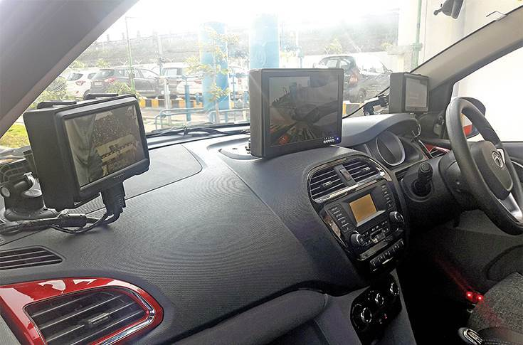Tata AutoComp has 10 JVs with global component majors. This surround view system, developed by Tata Ficosa, uses three screens, each providing a different visual.