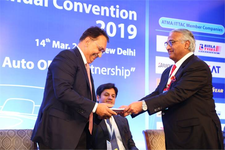 K M Mammen, chairman and MD, MRF Ltd, and ATMA's new chairman, welcoming Vikram S Kirloskar, president, ARAI and vice-chairman, Toyota Kirloskar Motor.