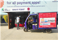 A Zyngo e-loader using one of Sun Mobility's swap points, located at an Indian Oil station.