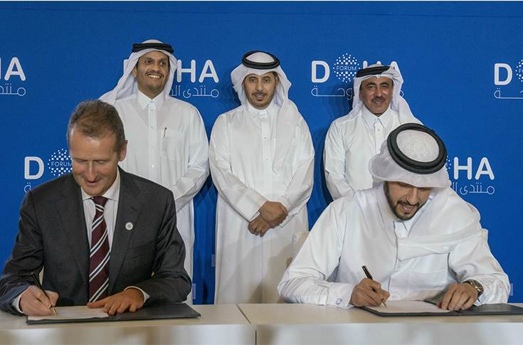 VW CEO Dr Herbert Diess and QIA CEO  Mansoor Bin Ebrahim Al-Mahmoud during the signing ceremony at Doha