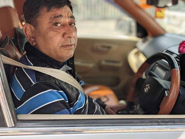 New Delhi-based Naveen Sewani, owner of a 2013-model Maruti Suzuki Dzire diesel which has clocked 165,000km. He is replacing the car with a Wagon R CNG due to rising diesel prices.