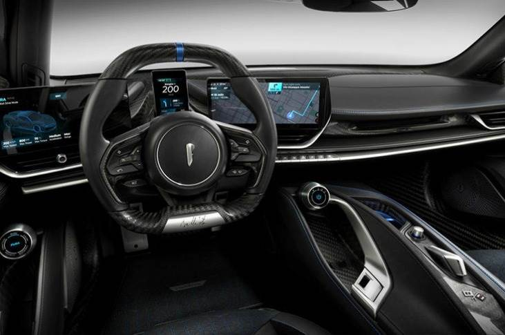 They include a more ergonomic steering wheel made taller and narrower as well as a relocated charging port surrounded by LED lights.