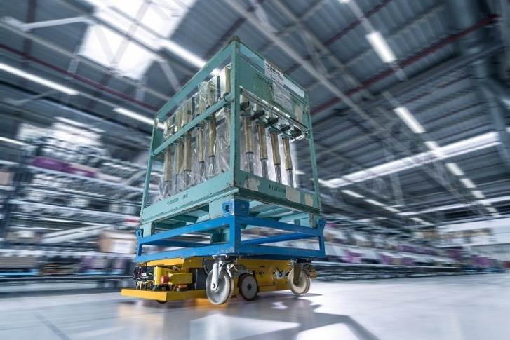 Smart Transport Robot carrying roller containers through the logistics hall at BMW Group Plant Wackersdorf.