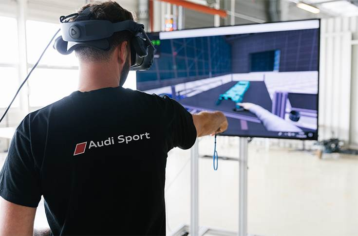 Audi employees working on the VR technology