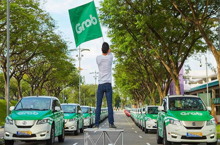 Grab ride sharing fleet backed by Toyota