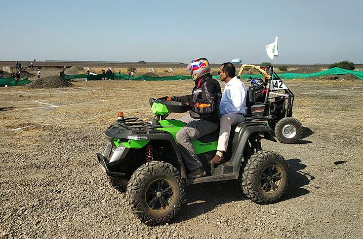 Pawan Goenka on the the electric ATV at the Bajaj SAE India event in Pithampur
