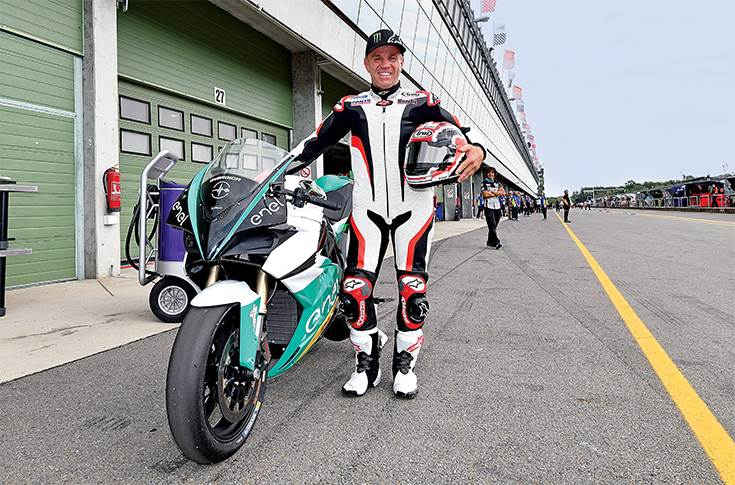 Racing legend Randy  Mamola with an Energica.