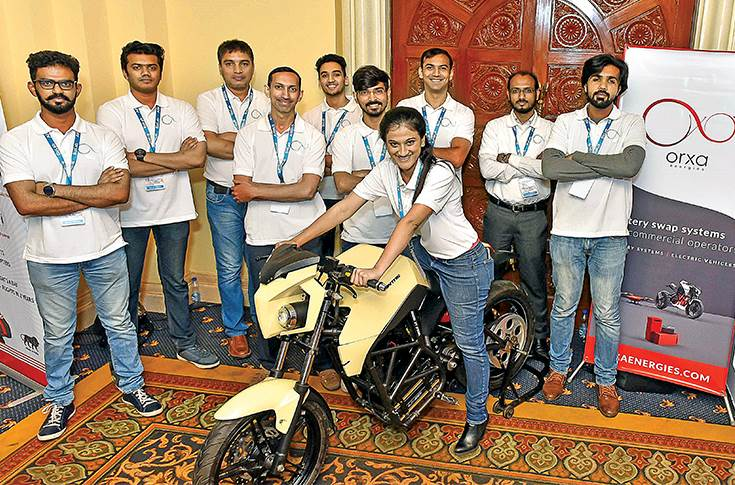 Orxa energy team with the Mantis electric motorcycle